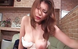 Aroused busty jap sex queen fucking cock on a leather sofa